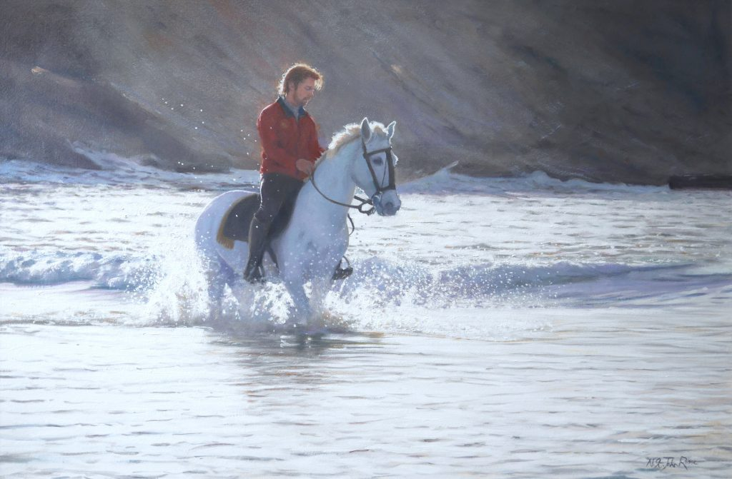 A horse being put through his paces in the sea.