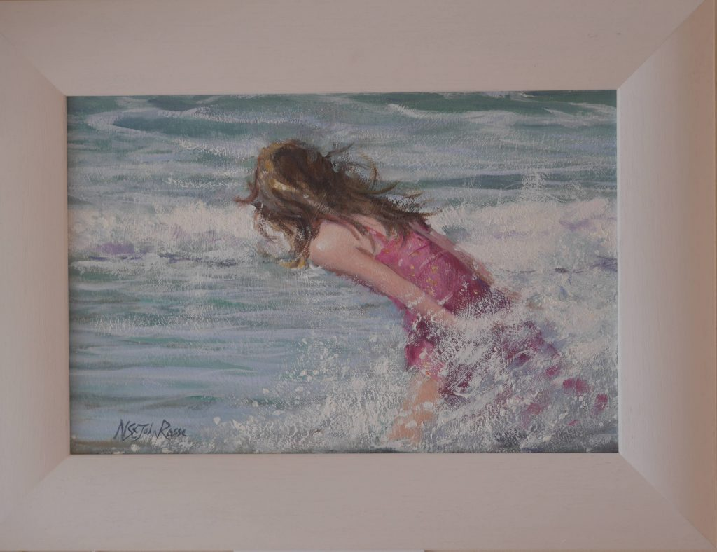 a child enjoying the waves